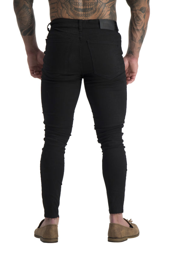 06 Muscle fit jeans Black ripped knee cropped back